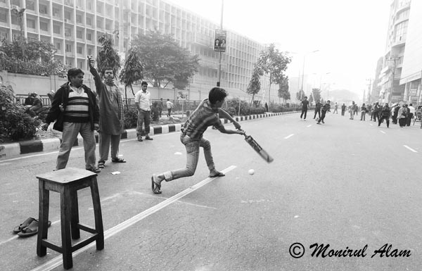 DEC 18 2012-Dhaka, Bangladesh- Communist Party of Bangladesh ( CPB) activists plays cricket on the street  during a nationwide strike in Dhaka on Tuesday. The daylong strike called by the Communist Party of Bangladesh (CPB) and Bangladesh Shamajtantrik Dal (BSD), demanding a ban on all communal political parties including Jamaat-e-Islami. © Monirul Alam