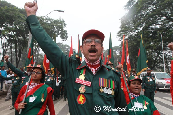 DEC 18 2012-Dhaka, Bangladesh- Members of Muktijodha Sangsha, a non-political welfare association of ex-combatants form the war of liberation in 1971, during a protest rally against recent Jamaat-eIslami activity and to demand and ensure the quick trail of war criminals. © Monirul Alam