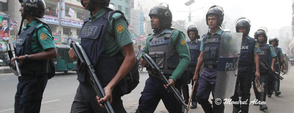 DEC 10 2012-Dhak, Bangladesh- Police patrols in front of BNP Nayapalton office on Monday. The activists of BNP and its close ally Jamaat-e-Islami set fire to at least nine buses and vandalized many others in the capital on the eve of Tuesday's dawn-to-dusk nationwide strike. They are demanding restoration of the caretaker government system. © Monirul Alam