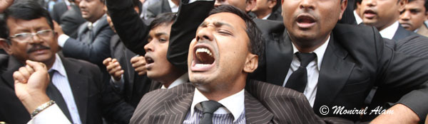 DEC 11 2012-Dhak, Bangladesh- BNP lawyers shout slogan in form of CMM court during the Hortal hour.BNP and its close ally Jamaat-e-Islami observed dawn-to-dusk nationwide strike on Tuesday. They are demanding restoration of the caretaker government system. © Monirul Alam
