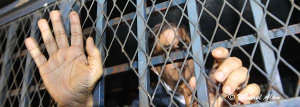 DEC 11 2012-Dhak, Bangladesh- BNP acting secretary general Mirza Fakrul Islam Alamgir show his hand form the prison van on Tuesday, he sent to jail after being denied bail in two cases filed with Sher-e-Bangla Nagar and Paltan police stations. BNP and its close ally Jamaat-e-Islami observed dawn-to-dusk nationwide strike on Tuesday. They are demanding restoration of the caretaker government system. © Monirul Alam