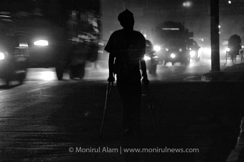 A street bagger and drug addict Zahid said, no one can help me, so I don't have any other way except begging. I leave on the street and everyday earn taka 30/40. I am also taking drugs for frustrating my life hood. Bangla Motor Dhaka. © Monirul Alam