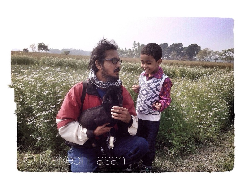 Me and my sweet baby Megh during our short trip in our village photo taken by Mahade Hassan
