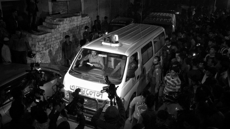 December 24, 2016 - Dhaka, Bangladesh - Police ambulance carry a suspected Islamist dead body to the Dhaka Medical Hospital after and operation to storm an alleged militant hideout in Dhaka on December 24, 2016, as a team from the counterterrorism unit of Dhaka Metropolitan Police cordoned off a three-storey building in the capital. Two female militants along with two children surrendered to the cops, 1 female and a teen militant killed themselves during police raid by exploding suicidal vest outside their den while acting to surrender to the cops. © Monirul Alam